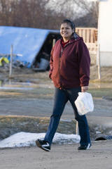 Audrey Nakogee walking on Revillon Road South in Moosonee April 19, 2006